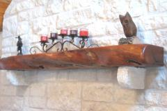 A finished mesquite mantel.