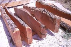 A row of raw mesquite mantels waiting to be finished.